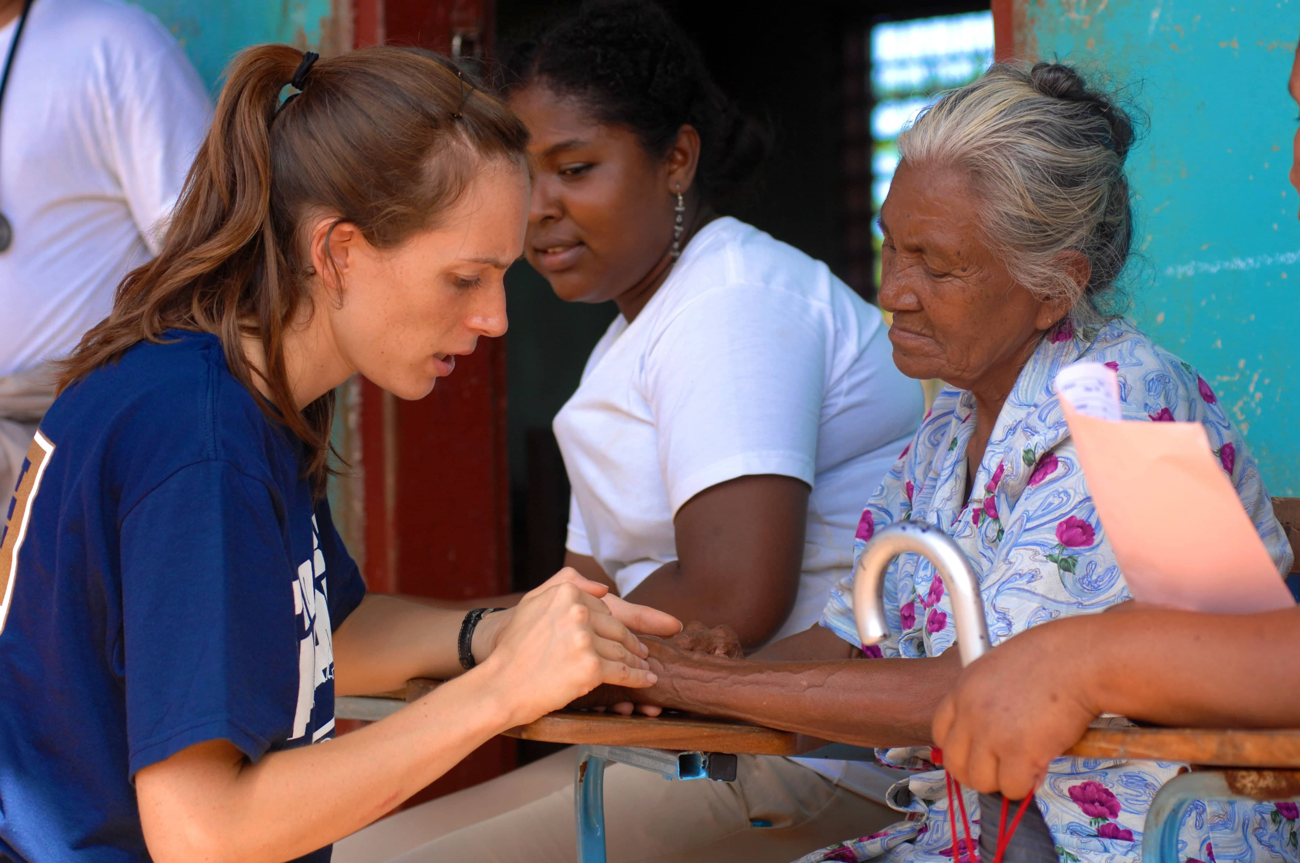 080815-N-7540C-148 PUERTO CABEZAS, Nicaragua (Aug.15, 2008) Project Hope volunteer Sara Joyce, embarked aboard the amphibious assault ship USS Kearsarge (LHD 3), examines the hand of an elderly Nicaraguan woman at a medical clinic at Juan Comenius High School during a Continuing Promise 2008 humanitarian assistance project. Kearsarge is the primary platform for the Caribbean phase of Continuing Promise, an equal-partnership mission involving the United States, Canada, the Netherlands, Brazil, Nicaragua, Panama, Colombia, Dominican Republic, Trinidad and Tobago and Guyana. (U.S. Navy photo by Mass Communication Specialist 1st Class David G. Crawford/Released)